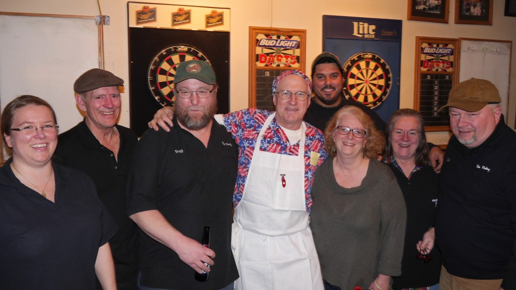 Ivory Jacks Dart Team, 8 people lined up for a smiling photo